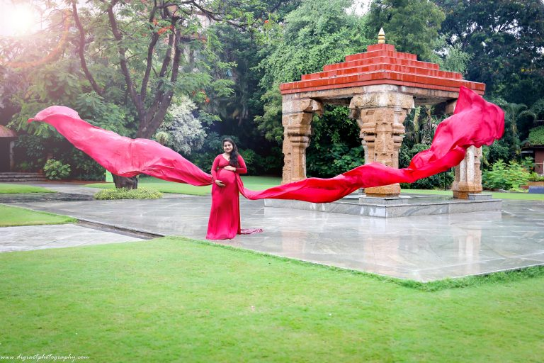 Maternity shoot in Alankrita Resort Red Flowing Gown